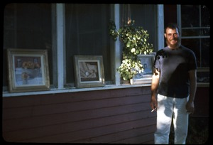 Thumbnail of Iago, smoking a cigarette on the porch, Montague Farm Commune