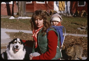 Thumbnail of Judie, baby Phoebe (in backpack), Schuman the dog, and cat, Montague Farm Commune