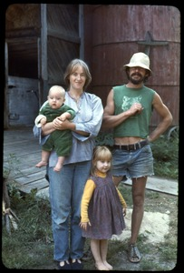 Thumbnail of Sandra Marr, Smokey Fuller, and children in front of the barn, Montague Farm Commune