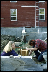 Thumbnail of Janice Frey and Sam Lovejoy working on the greenhouse foundation, Montague Farm Commune
