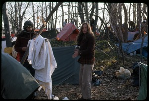Thumbnail of Camp with Alan Berman (partially obscured) and Robin Conley: Occupation of the Seabrook Nuclear Power Plant Occupiers among the tents in the camping area