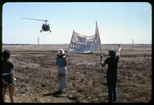 Thumbnail of We're being followed: Occupation of the Seabrook Nuclear Power Plant Helicopter buzzing occupiers holding a banner