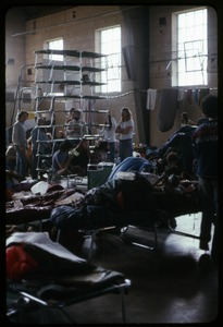 Thumbnail of Being creative with new cots: Occupation of the Seabrook Nuclear Power Plant Arrested occupiers stacking cots in a pyramid on the armory floor