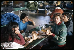 Thumbnail of  Eating at cot 'table': Occupation of the Seabrook Nuclear Power Plant Occupiers having lunch laid out of a cot: Nancy Hazard, Alan             Berman, and  Cate Woolner (clockwise from front)