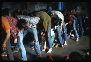 Thumbnail of  Tunnel taps: Occupation of the Seabrook Nuclear Power Plant Occupiers playing around on the armory floor, crawling between the legs of             others