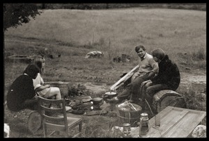 Thumbnail of Relaxing outside the house, in conversation, Montague Farm commune Ira Karasick (left, facing camera)