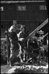 Thumbnail of Janice Frey (left) and Nina Keller with cow, Montague Farm commune