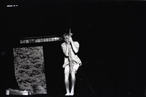 Thumbnail of James 'Lazarus' Tapley swinging from a rope in the barn, Montague Farm commune
