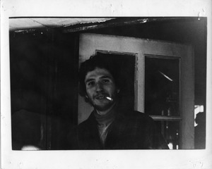 Thumbnail of Albert Maioletesti, smoking a cigarette, Montague Farm Commune