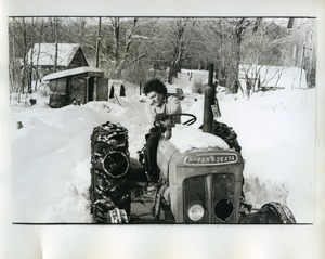 Thumbnail of Frank Febbell, driving the Super Dextra tractor through the snow, Packer Corners             Commune