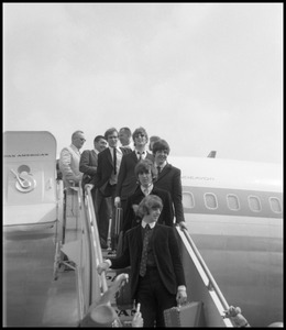 Thumbnail of Ringo Starr, George Harrison, Paul McCartney, and John Lennon descending the ramp from a Pan             American airways Boeing 707