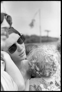 Thumbnail of Mother and infant daughter in the audience, waiting to see Taj Mahal in concert, Newport Folk Festival