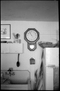 Thumbnail of Kitchen sink, clock, and surroundings