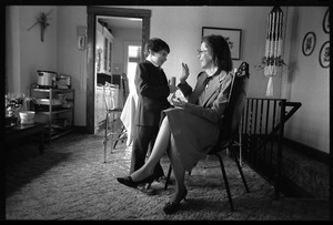 Thumbnail of Mother and son talk as he awaits his first communion
