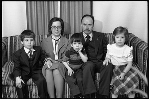 Thumbnail of Family portrait, seated on a couch, as the son awaits his first communion