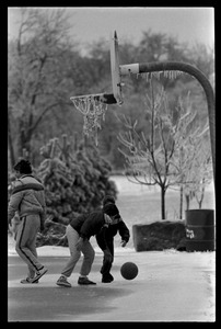 Thumbnail of Boys playing basketball outdoors after school is cancelled for an ice storm