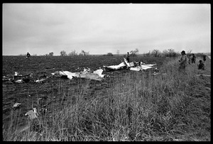 Thumbnail of Wreckage of a small engine plane crashed in a field during a tornado Police inspect the wreckage