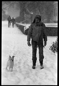 Thumbnail of Woman walking her dog in the snow