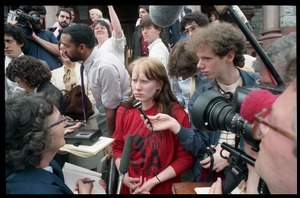 Thumbnail of Amy Carter being interviewed by the press on the front steps of the Hampshire             County Courthouse after her acquittal in the CIA protest case Carter is wearing a 'Put the CIA on trial' t-shirt