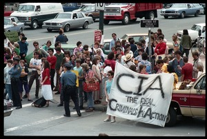 Thumbnail of Anti-CIA protesters gathered at the corner of Main nd Gothic Street outside the Northampton Court House during the CIA             protest trial Protesters carry a banner reading 'CIA, the real criminals in action'