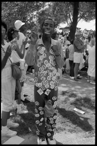 Thumbnail of Man decked out with dozens of buttons from the 25th Anniversary of the March on             Washington