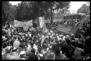 Thumbnail of Speakers arriving at the 25th Anniversary of the March on Washington Jesse Jackson, Coretta Scott King (front center), and other speakers approach the stage through the crowd