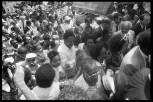 Thumbnail of Speakers arriving at the 25th Anniversary of the March on Washington Jesse Jackson, Coretta Scott King (front center), Joseph Lowery (to right of             King, partially obscured), Benjamin Hooks (to right of Lowery), and other speakers approach the stage through the crowd