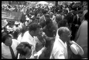 Thumbnail of Speakers arriving at the 25th Anniversary of the March on Washington Jesse Jackson, Coretta Scott King (front center), Joseph Lowery (to right of             King), and other speakers approach the stage through the crowd