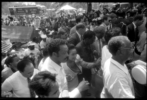 Thumbnail of Speakers arriving at the 25th Anniversary of the March on Washington Jesse Jackson, Coretta Scott King (front center), Joseph Lowery (to right of             King), Benjamin Hooks (to right of Lowery), and other speakers approach the stage through the crowd