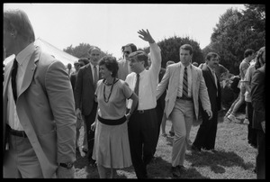 Thumbnail of Kitty and Mike Dukakis (hand over face) walking hand-in-hand at the 25th Anniversary of the March on Washington