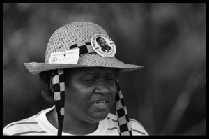 Thumbnail of Catherine Frazier of the Urban League of Rhode Island, wearing a straw hat with Martin Luther King's image on a button             and the phrase the 'Keep the dream alive', 25th Anniversary of the March on Washington