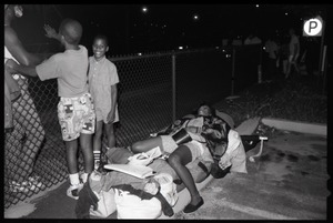 Thumbnail of Woman sleeping on a makeshift bed as two boys look on, 25th Anniversary of the March on Washington