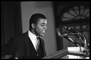 Thumbnail of Ezell Blair [Jibreel Khazan] (?) speaking at a podium at the Youth, Non-Violence, and Social Change conference, Howard             University