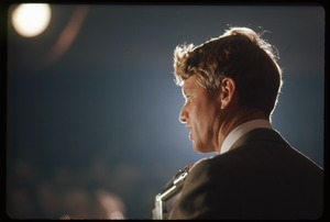 Thumbnail of Robert F. Kennedy on the campaign trail, on stage while stumping for Democratic             candidates in the northern Midwest