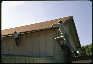 Thumbnail of Sons of Robert F. Kennedy leaping between rooftops