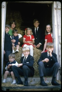 Thumbnail of Children of Robert F. and Ethel Kennedy posed in the doorway to a barn