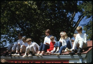 Thumbnail of Children of Robert F. and Ethel Kennedy posed on edge of a shed roof