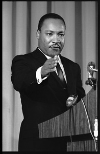 Thumbnail of Martin Luther King, Jr., speaking from a podium, pointing to the audience