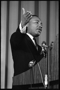 Thumbnail of Martin Luther King, Jr., speaking from a podium, raising his hand