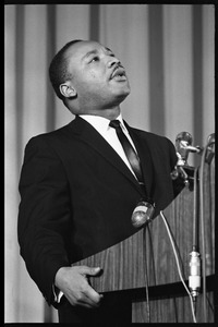 Thumbnail of Martin Luther King, Jr., speaking from a podium