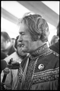 Thumbnail of Timothy Leary surrounded by press and supporters, drinking from a paper cup
