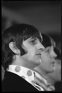 Thumbnail of Ringo Starr during a Beatles press conference: in profile: Paul McCartney             partly visible in the background