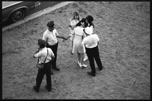Thumbnail of Police assisting an overwrought Beatles fan before the concert at D.C. Stadium