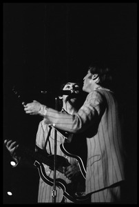 Thumbnail of Paul McCartney and John Lennon (the Beatles) in concert at D.C. Stadium