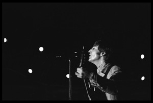 Thumbnail of John Lennon (the Beatles) playing guitar and singing in concert at D.C. Stadium
