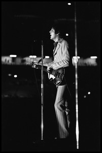Thumbnail of Paul McCartney (the Beatles) playing bass and singing in concert at D.C.             Stadium: full-length portrait