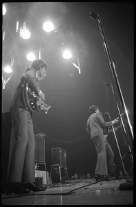 Thumbnail of George Harrison, and Paul McCartney (from left) in concert with the Beatles, Washington Coliseum