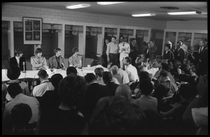 Thumbnail of Ringo Starr, Paul McCartney, John Lennon, and George Harrison (l. to r.) seated at a table during a Beatles press conference