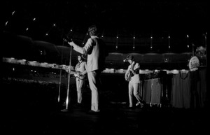 Thumbnail of Beatles performing in concert at the Washington Coliseum Paul McCartney, George Harrison, John Lennon, and Ringo Starr (l. to r.)