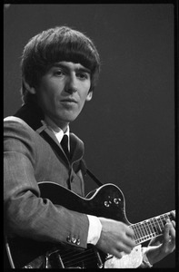 Thumbnail of George Harrison playing guitar in concert with the Beatles, Washington Coliseum